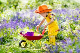 Kids In Bluebell Woodland. Child With Flowers, Garden Tools And